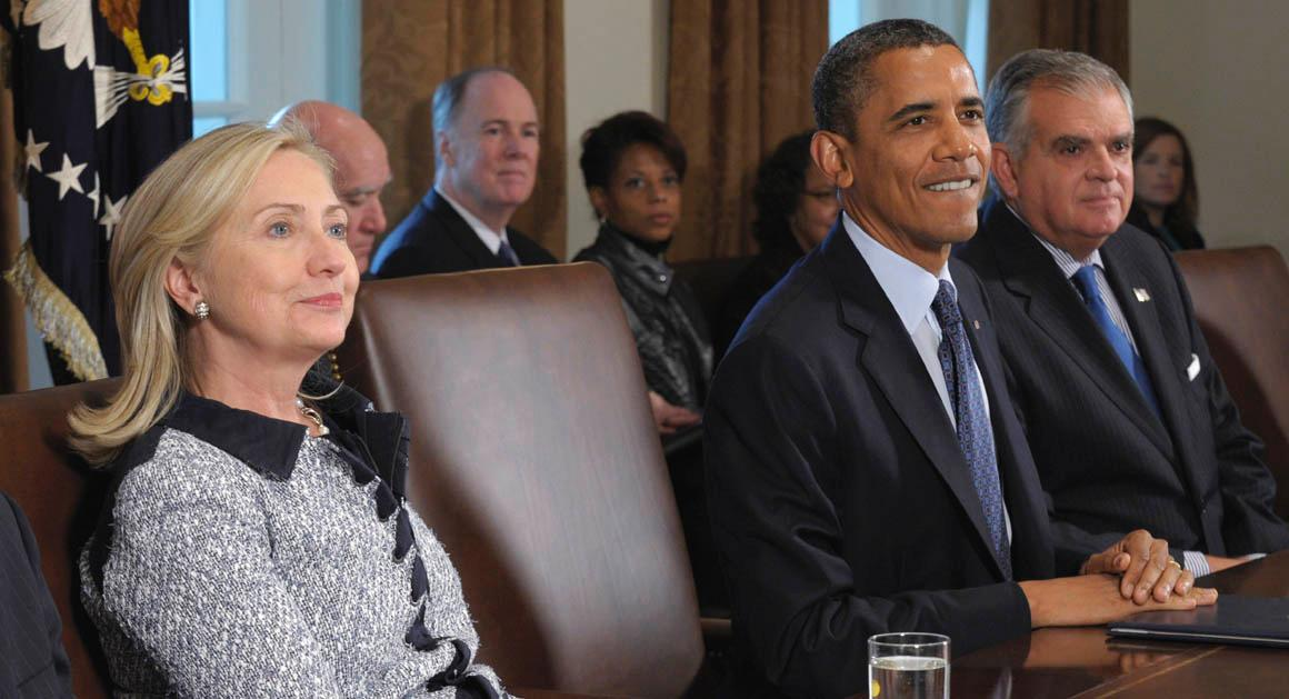 President Barack Obama, flanked by Secretary of State Hillary Rodham Clinton, left, and Transportation Secretary Ray LaHood, right, makes a statement at the start of a Cabinet Meeting at the White House in Washington, Monday, Oct. 3, 2011. (AP Photo/Susan Walsh)