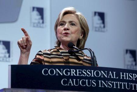 U.S. Democratic presidential candidate Hillary Clinton delivers remarks at the Congressional Hispanic Caucus Institute's 38th annual Awards Gala in Washington October 8, 2015. REUTERS/Yuri Gripas